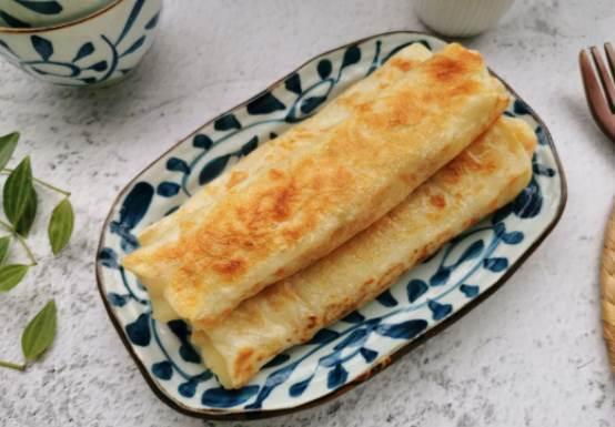 不用和麵揉面,卷點土豆絲就做出的早餐餅,太美味了!